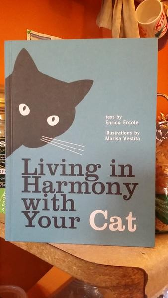 Living in Harmony with Your Cat by Enrico Ercole [An inquisitive black cat looms onto the cover.]