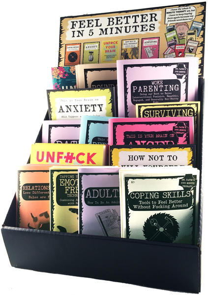 A large collection of therapy zines in a display box