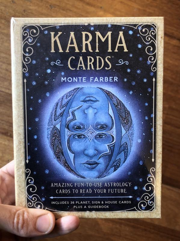 Hand holding Karma Cards