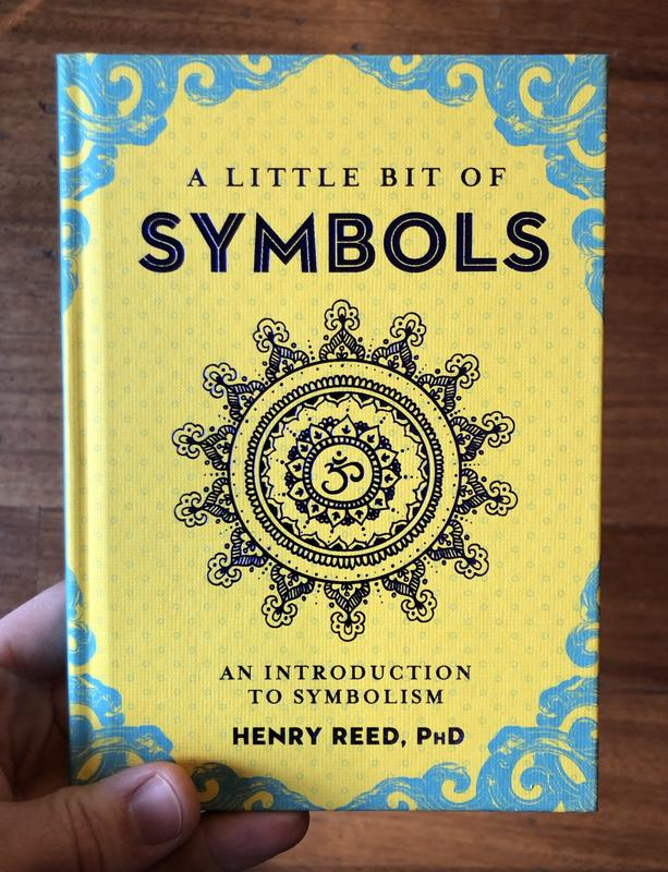 Cover of A Little Bit of Symbols, which features a mandala with an om symbol in the center