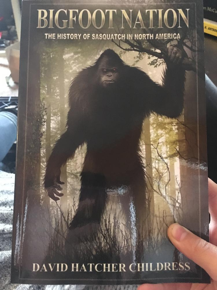 big looming image of hairy wood creature with title along top of book and author along the bottom