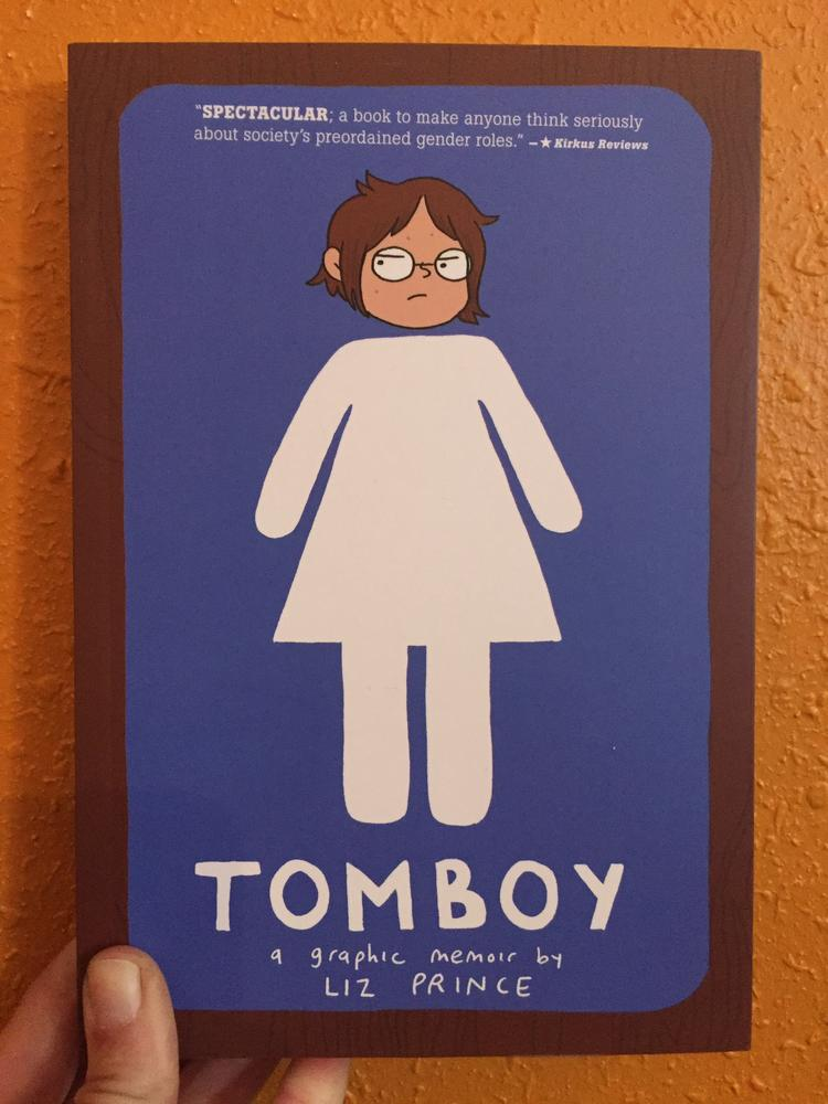 Tomboy by Liz Prince [A woman's body as depicted by bathroom signs topped by a disgruntled lady's head]