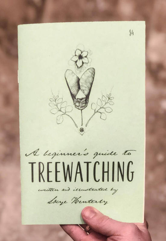 a zine cover with tree seeds and flowers.