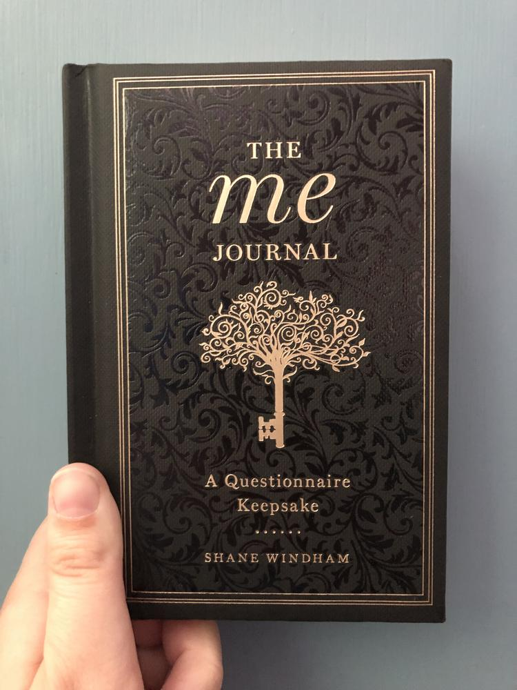 Me Journal, The by Shane Windham [A key that is also a tree adorns an ornate black cover]
