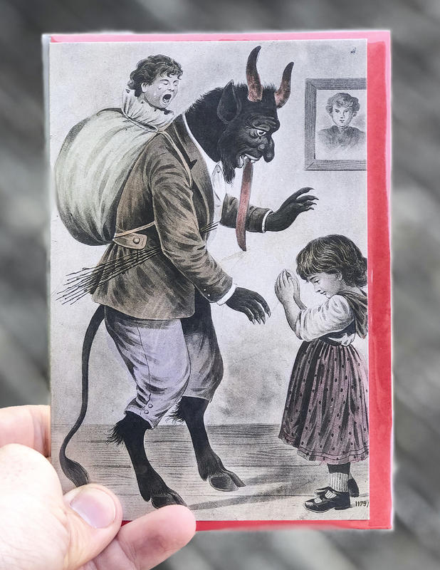 A devilish goat-like figure with a child in a bag strapped to his back towers over a small girl deep in prayer.