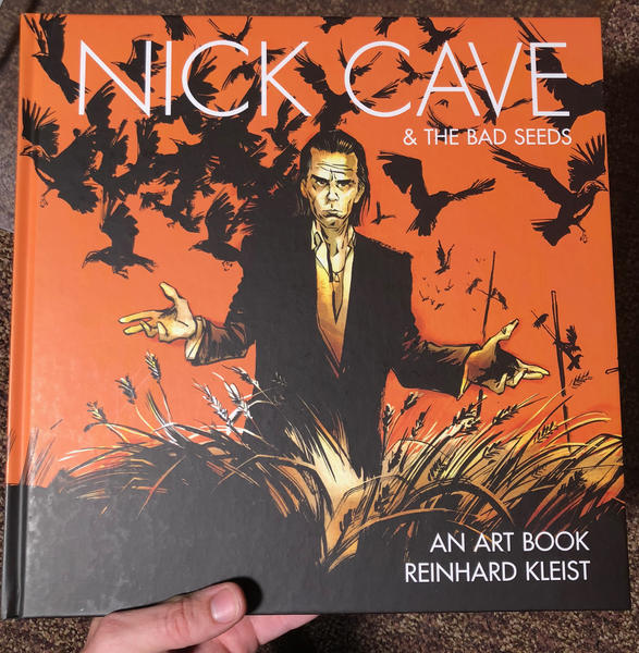 An illustration of Nice Cave standing in a field, crows flying around him.