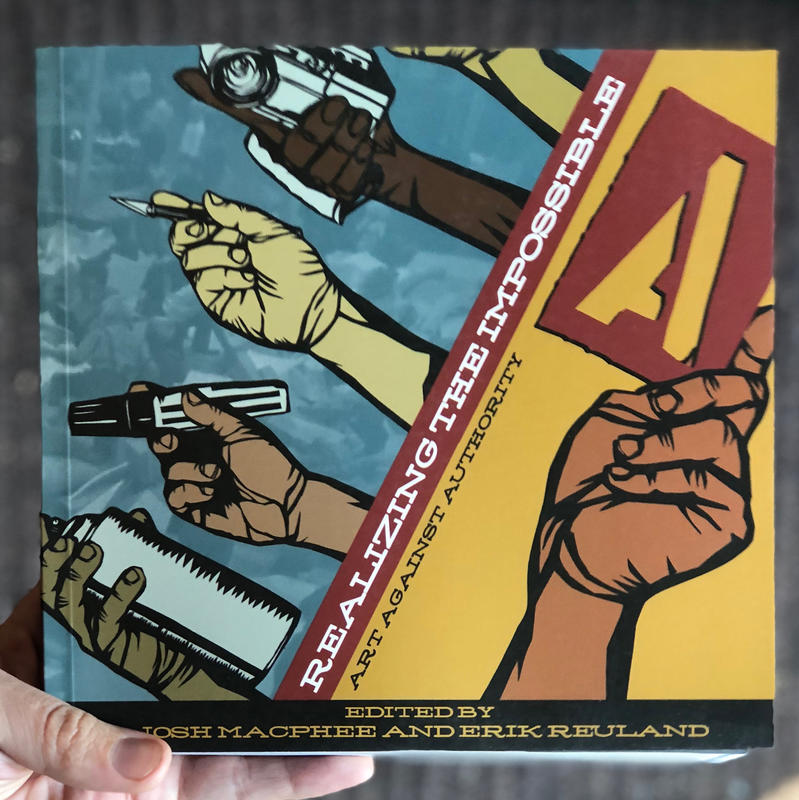 the cover of Realizing the Impossible book: Art Against Authority, which features a variety of hands holding up art supplies