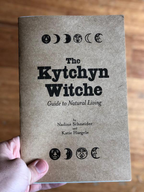 Cover of The Kytchyn Witche which features phases of the moon on the top and bottom