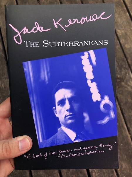 A blue tinted photo of Kerouac with a black border blowup