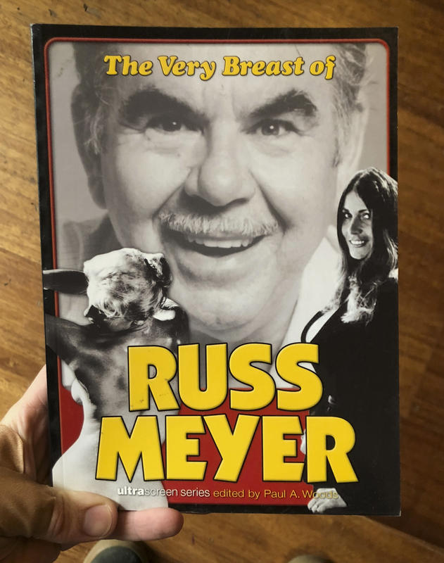 A black and white image of Russ Meyer, juxtaposed against images of scantily clad women.