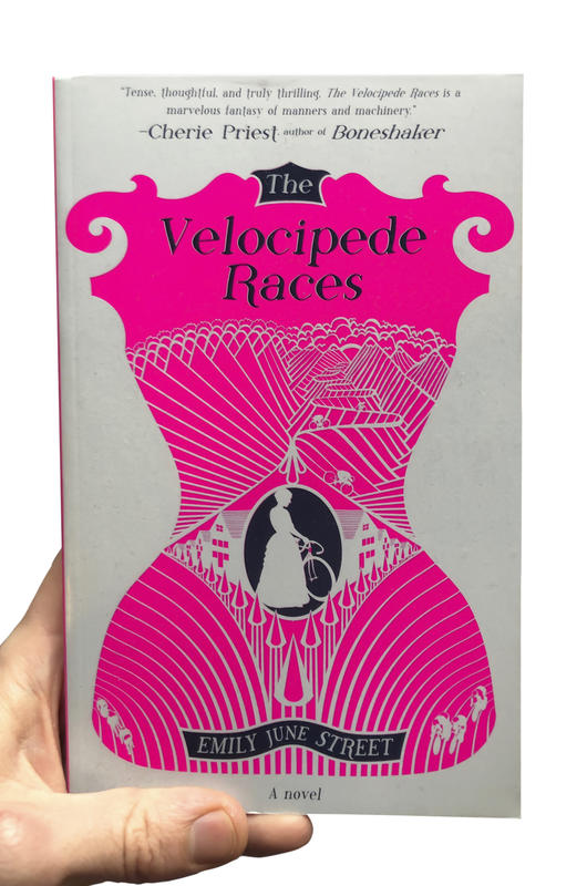 A white book with an illustration of a pink corset and a women in a dress with a bicycle