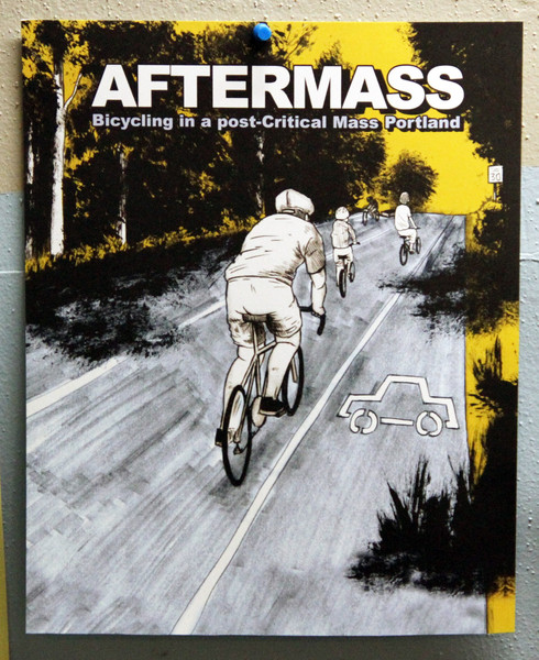 A poster with an illustration of 4 people biking on the road next to a car lane which has taken the place of the bike lane