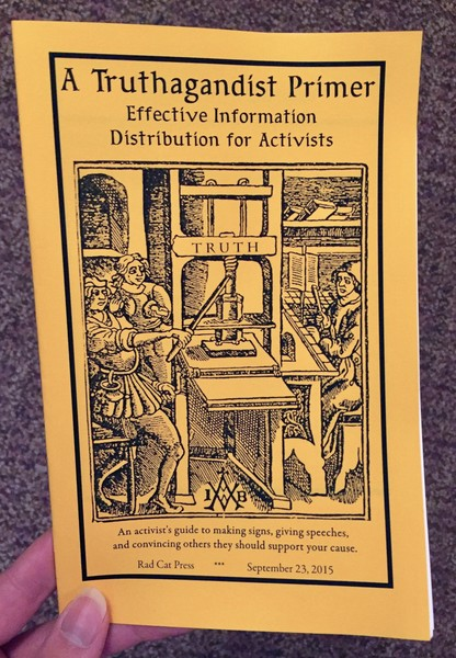 Cover of A Truthagandist Primer which features a black and white illustration of three people running a printing press which has the word TRUTH on it.