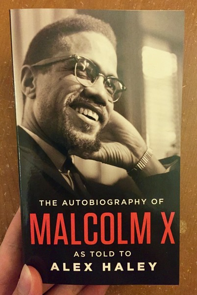 Autobiography of Malcolm X, The by Malcolm X and Alex Haley [A black and white portrait of Malcolm X]