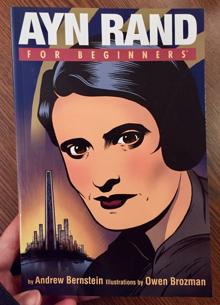 A book cover depicting Ayn Rand's face with a city outlined in the bathroom.