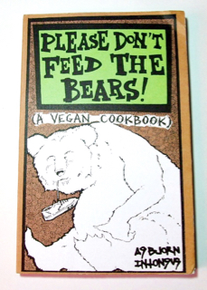 A book cover with a drawing of a fat, content bear eating shoes