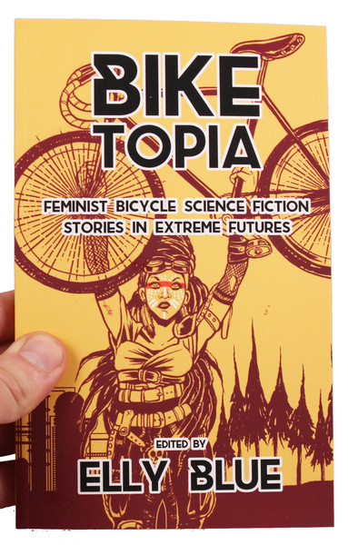 Biketopia cover featuring a costumed woman holding a bicycle above her head