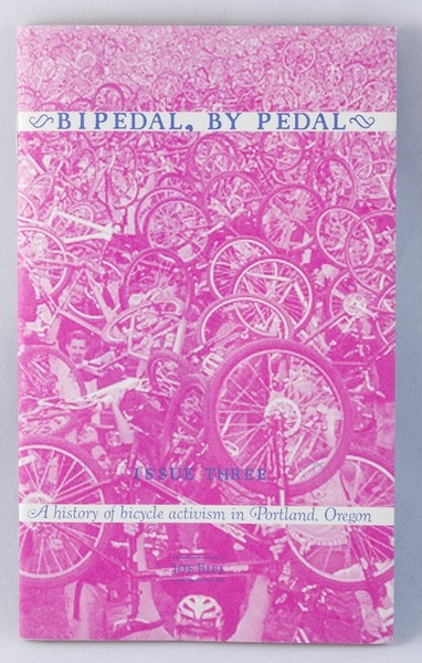 A pink zine with a photo of a bike-yard
