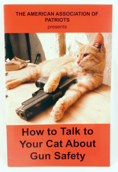 How to Talk to Your Cat About Gun Safety zine cover by the American Association of Patriots
