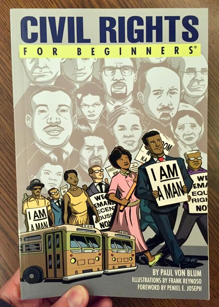 book cover depicting African Americans walking in a line with signs on a background of faces