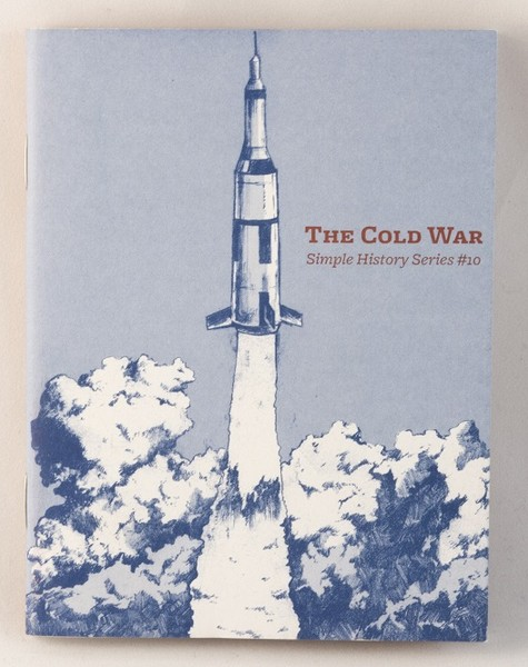 A zine with an illustration of a rocket lifting off
