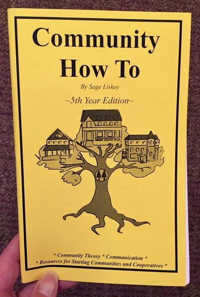 Cover of Community How To, which features three large houses perched on different branches of the same tree