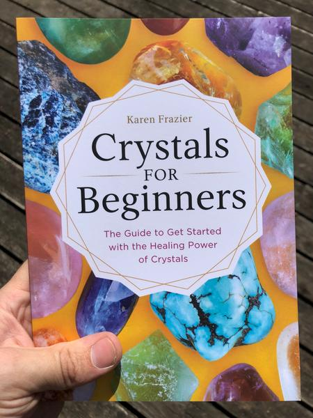 yellow background with colored crystals and a white crystal shape in the middle with words: Crystals for Beginners: The Guide to get started with the healing power of crystals