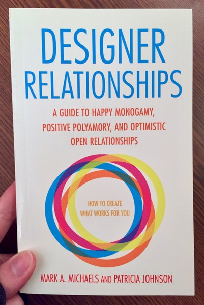 the cover of Designer Relationships: A Guide to Happy Monogamy, Positive Polyamory, and Optimistic Open Relationships, which has a series of interlocking rainbow colored circles prominently featured