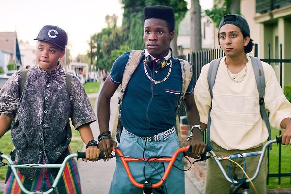 three brown, queer teens on bikes in a still from the movie dope