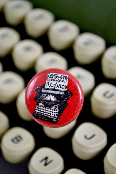 Typewriter button revolution between lines