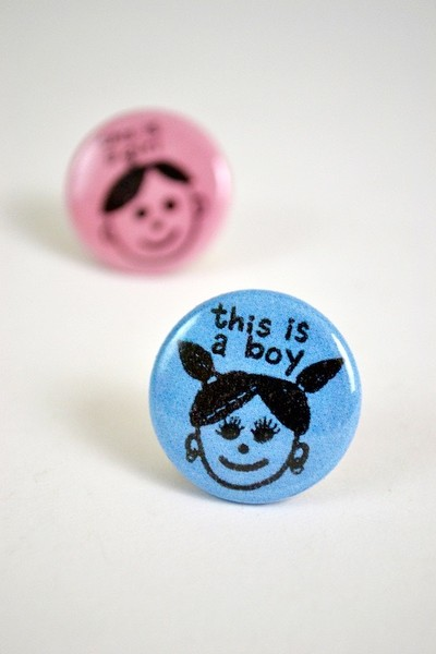 this is a boy button with person with pigtails