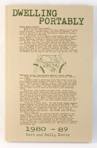 A yellowish book with green text and an illustration of the frame of a bike