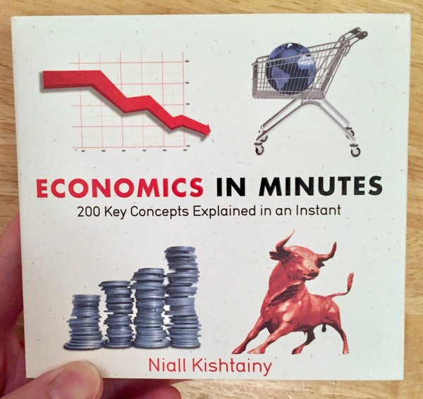 white book cover with four pictures of coins, a bull, a globe in a shopping cart, and a graph