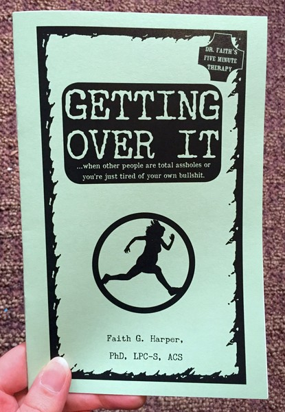 Cover of Getting Over it, which is a green zine with a person running on the cover
