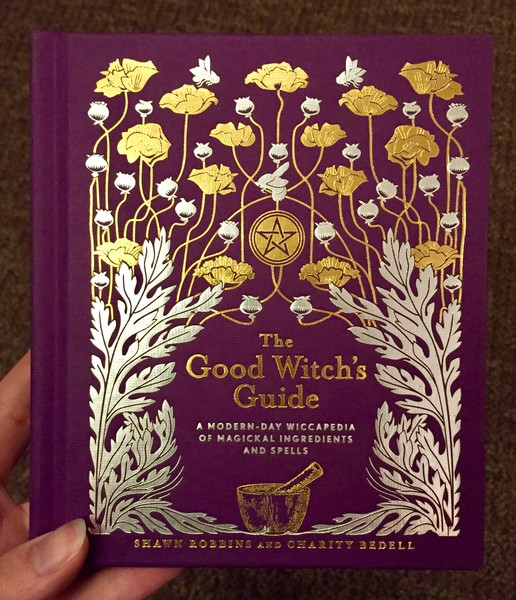 Cover of Good Witch's Guide: A Modern-Day Wiccapedia of Magickal Ingredients and Spells which features a bunch of herbs growing freely around a mortar and pestle