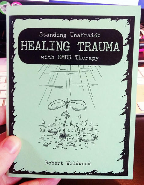 Cover of Standing Unafraid: Healing Trauma with EMDR Therapy which features a drawing of a plant sprout basking in the rays of the sun