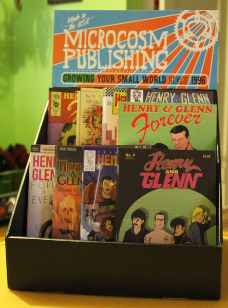 a display box featuring a set of Henry & Glenn books and zines