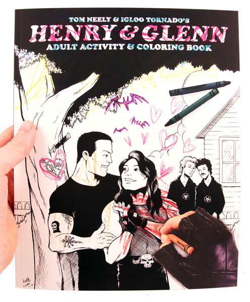 A hand with a black fingerless glove colors in Henry & Glenn next to a tree on the cover