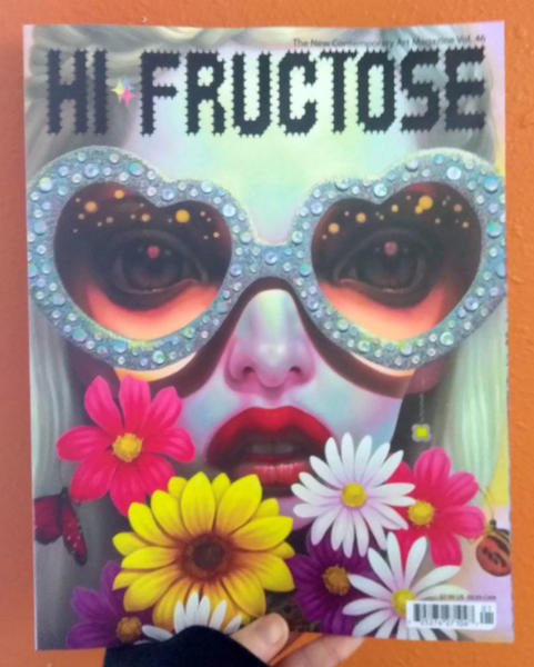 Hi Fructose, Graig Gleason, Koralie, Ryan Heshka  (A model wearing heart sunglasses and holding a bouquet of flowers up to her overly lipsticked lips)