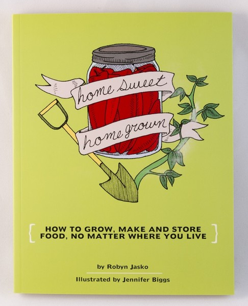 a greenish, yellowish book with illustrations of a red jar, a shovel, and some plants