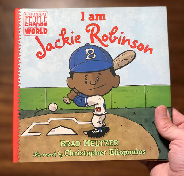cute cartoon jackie robinson about to smack a home run