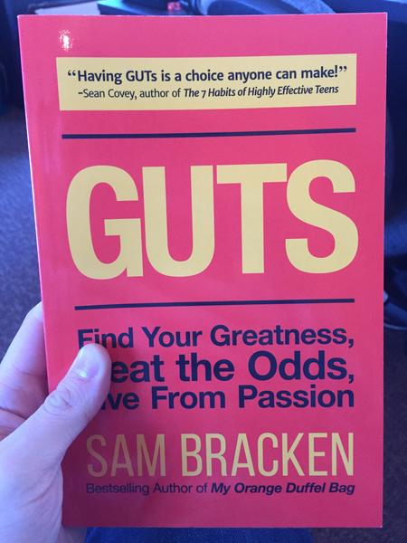 GUTS: Find Your Greatness, Beat the Odds, Live From Passion by Sam Bracken (best selling author of My Orange Duffel Bag) (Yellow and black lettering on a red cover)