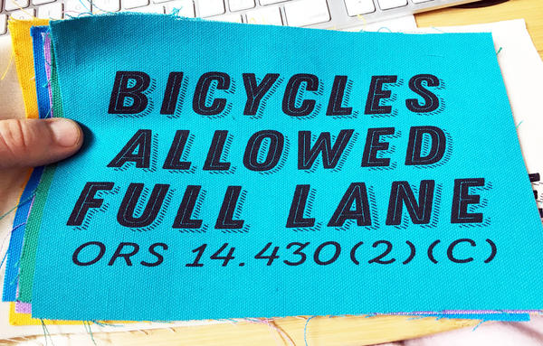 "patch with text ""bicycle allowed full lane"""