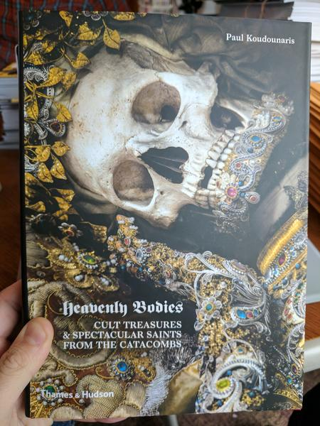 Heavenly Bodies: Cult Treasures & Spectacular Saints from the Catacombs by Paul Koudounaris (a photo of a gold and jewel encrusted skeleton with a crown of golden leaves)