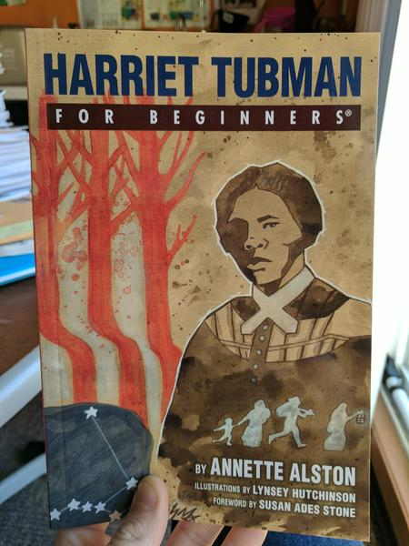book cover depicting Harriet Tubman in front of three red trees