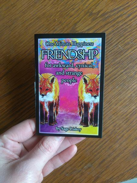 Cover of Friendship: for awkward, cynical, and strange people (One Minute Happiness) which features a drawing of two foxes on a pink background