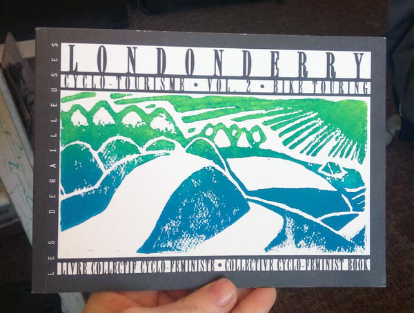 a block print of a winding, hilly road in the sun