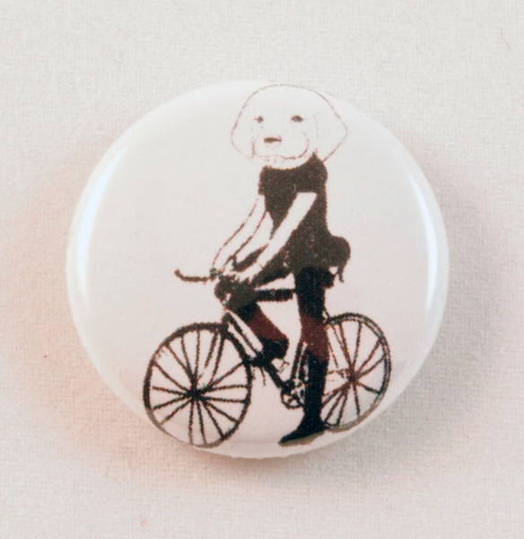dog on a bicycle button