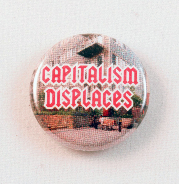 Capitalism displaces button