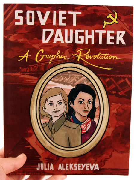 Red book cover with a bridge in the background and a framed portrait of two young girls in front